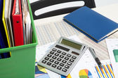 Calculator and documents and money on a business background — Stock Photo