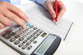 The businessman and green calculator — Stock Photo