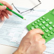 Stock Photo: Businessmand green calculator