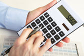 The businessman and calculator — Stock Photo