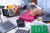 The businesswoman and calculators — Stock Photo