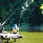 Two boys fishing on the lake — Stock Photo #50084777