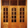 Closed natural wooden triple door with glass isolated — Stockfoto