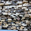 Background of dry chopped firewood logs in pile — Stock Photo #12686164