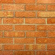 Red weathered stained old brick wall — Stock Photo