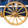 Foto Stock: Antique Cart Wheel made of wood and iron-lined, isolated
