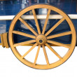 图库照片: Antique Cart Wheel made of wood and iron-lined, isolated
