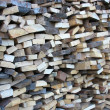 Background of dry chopped firewood logs in pile — Stock Photo #12886002