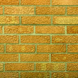 Orange weathered stained old brick wall - Stock Photo