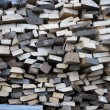 Background of dry chopped firewood logs in pile — Stock Photo #14595323