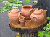 Clay pots on wooden support over autumn background — Stock Photo