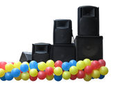 Powerful concerto audio speakers and balloons on stage isolated — Stock Photo