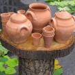 Foto Stock: Clay pots on wooden support over autumn background