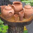 Clay pots on wooden support over autumn background — Foto Stock #16057293