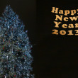 Christmas and New Year tree over black background — Stock fotografie