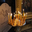 Stockfoto: Candles burning in interior of church