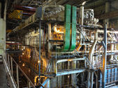 Giant pipes, tubes and equipment inside power plant, night scene — Stockfoto