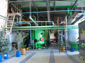 Industrial tanks, machinery, pipes, tubes inside chemical plant — Stock Photo