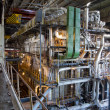Giant pipes, tubes and equipment inside power plant, night scene — Stock Photo