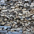 Background of dry chopped firewood logs in pile — Stock Photo