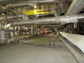 Giant pipes, tubes and equipment inside power plant, night scene — Photo