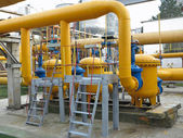 Natural gas station with yellow pipes power plant — Stock Photo