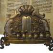 Stock Photo: Jewish Torah scroll and gold menorah candle support isolat