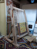 Ancient wooden vintage loom producing carpet — Stock Photo