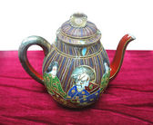 Decorated ancient colorful chinese ceramic teapot on red — Stock Photo