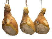 Three pork serrano ham isolated over white — Stock Photo