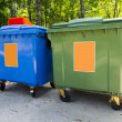 New colorful plastic garbage containers in park — Stock Photo