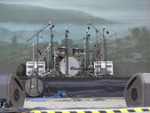 Drums set, powerfull speakers, amplifiers and stage equipment — Stock Photo