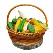 Corn vegetables and yellow leaves in basket isolated on white — Stock Photo