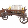 Vintage wooden cart with wine barrel, basket and pumpkin isolate — Stock Photo #36074527