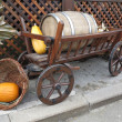 Vintage wooden cart with wine barrel, basket and pumpkin isolate — Stock Photo