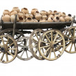 Old wooden cart full of clay pottery and wheels isolated over wh — Stock Photo