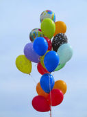 Bright colorful balloons over blue sky — Stock Photo