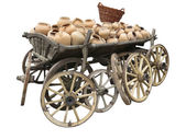 Old wooden cart full of clay pottery, wheels and wicker basket i — Stock Photo
