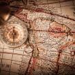 Brass Compass and Old Map — Stockfoto