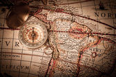 Brass Compass and Old Map — Stock Photo