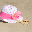 Starfish with hat on sand — Stock Photo