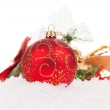 Red christmas ball with snow on white background — Stock Photo