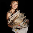Girl with newspapers in the hands — Stock Photo