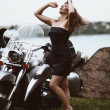 Young attractive girl and motorcycle — Stock Photo
