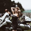 Young attractive girl and motorcycle — Stockfoto