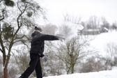 Boy throwing snowballs — Stock Photo