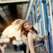 Girl  with flowing hair near the train — Stock Photo