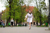 Happy girl running in the park — Stok fotoğraf