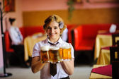 Waiter with beer in the hands — Stock Photo