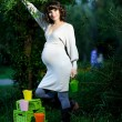 Happy young pregnant woman in the park — Stock Photo #36875425